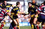 Jason O'Halloran passes to Gordon Slater, Wellington Hurricanes, Super 12 rugby union, 1998. Photo: PHOTOSPORT
