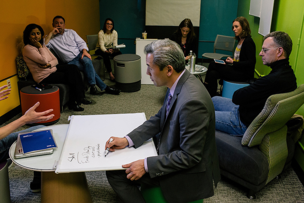 Dean Chang, Associate Vice President for Innovation and Entrepreneurship at the University of Maryland, center, meets with campus leaders in Innovation and Entrepreneurship from different departments in a room called the Garage, named after the place where Google started, during a semi-monthly meeting on April 1, 2015. UMD is part of a nationwide trend of colleges and universities  integrating entrepreneurship into the already established disciplines.
