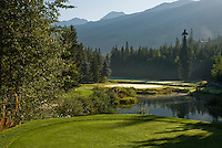 Mist rises from the groomed fairways and greens of the Whistler Golf Course in Whistler, BC Canada