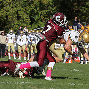 Salesianum Running Back Colby Reeder (28) is tripped up by Concord defensive back Luis Echevarria (7) in second quarter Saturday, Oct. 17, 2015 at Concord Stadium in Wilmington.