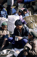 A trader at the Saturday market counts the takings with his sons. Namche Bazaar. Sollu Khumbu region of Nepal.
