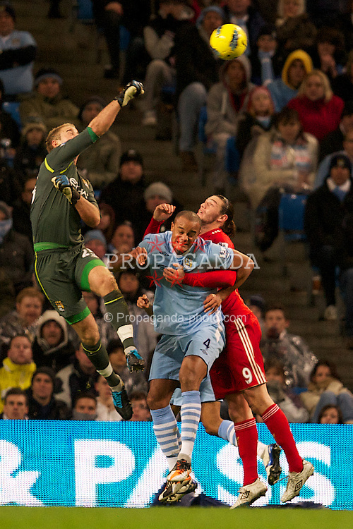 MANCHESTER, ENGLAND - Tuesday, January 3, 2012: Liverpool's Andy Carroll is thwarted by Manchester City's Vincent Kompany during the Premiership match at the City of Manchester Stadium. (Pic by David Rawcliffe/Propaganda)