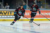 KELOWNA, CANADA - DECEMBER 5: Devin Steffler #4 and Lane Zablocki #27 of the Kelowna Rockets enter the ice against the Tri-City Americans on December 5, 2018 at Prospera Place in Kelowna, British Columbia, Canada.  (Photo by Marissa Baecker/Shoot the Breeze)