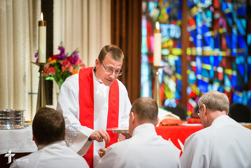 The Rev. Robert Mrosko, pastor, distributes the Sacrament during worship at Brookfield Lutheran Church on Sunday, March 29, 2015, in Brookfield, Wis. LCMS Communications/Erik M. Lunsford
