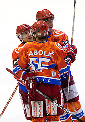Mitja Robar of Acroni Jesenice, Robert Sabolic of Acroni Jesenice and Douglas Nolan of Acroni Jesenice  celebrate during  ice-hockey match between HK Acroni Jesenice and EV Vienna Capitals of 44th Round of EBEL league, on January 30, 2011 in Arena Podmezkla, Jesenice, Slovenia. Acroni Jesenice defeated Vienna 4-3. (Photo By Vid Ponikvar / Sportida.com)