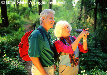 Active Aging Senior Citizens, Retired, Activities, Elderly Couple Outdoor Recreation, Staying Fit, Enjoying Nature Elderly Couple Birdwatching in Woods, Birding Hiking, Staying Young