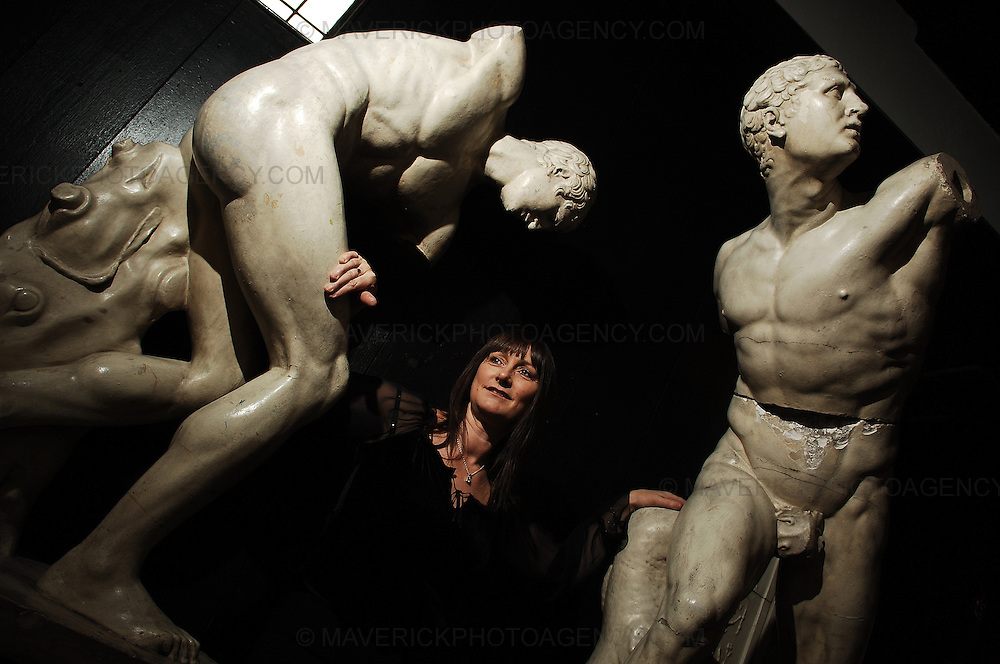 Over 200 architectural pieces are due to be restored at the Glasgow School of Art.  Pictured Alison Clark from the Glasgow School of Art with two of the sculptures due for restoration.