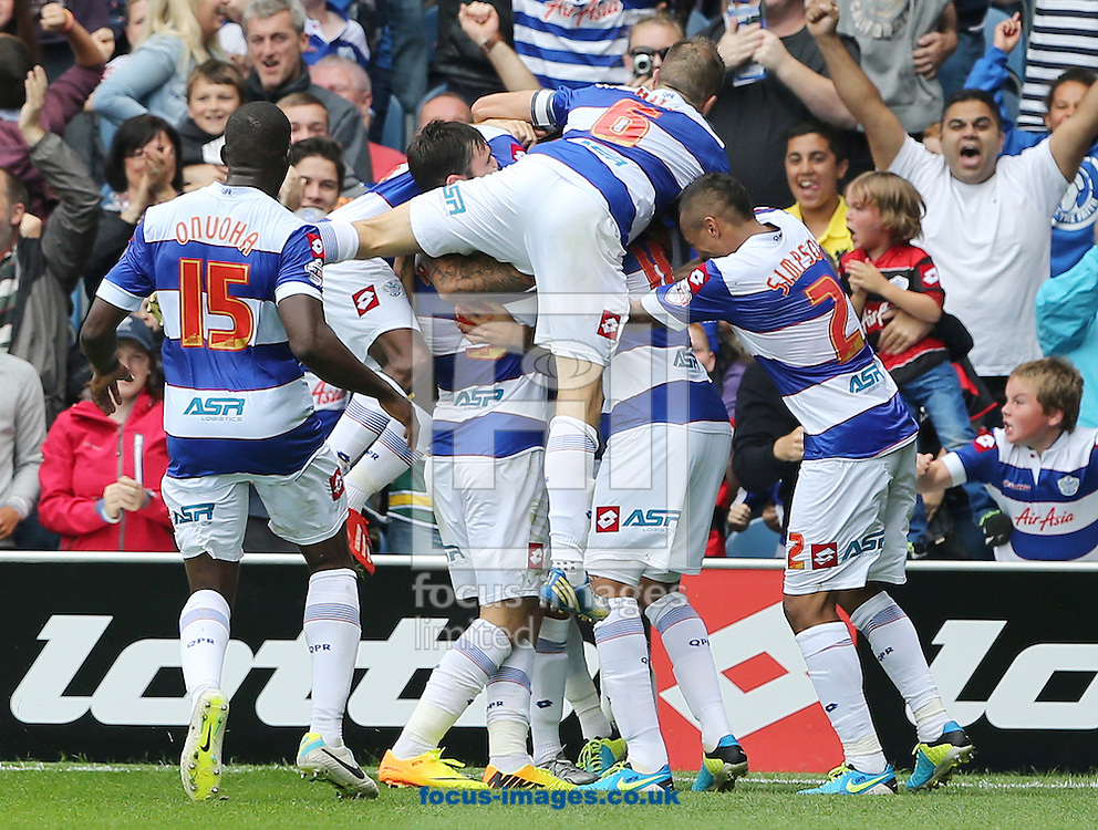 Picture by Richard Calver/Focus Images Ltd +447792 981244<br /> 17/08/2013<br /> Tom Hitchcock of Queens Park Rangers is mobbed by team mates after scoring the winning goal during the Sky Bet Championship match against Ipswich Town at the Loftus Road Stadium, London.