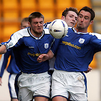 St Johnstone v Ross County..13.11.04<br />David Hannah and Ryan McCann close out Sean Kilgannon<br /><br />Picture by Graeme Hart.<br />Copyright Perthshire Picture Agency<br />Tel: 01738 623350  Mobile: 07990 594431