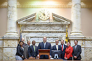 Annapolis, Maryland - May 12, 2015: Crafters of the Community Solar Bill stand for a photo in the Maryland House Delegate Chamber after Governor Larry Hogan signed it in to law at the Maryland State House in Annapolis Tuesday May 12, 2015. (L-R) Syeetah A. Hampton-El, Green & Healthy Homes Initiative, David O'Leary with Maryland Sierra Club, Jerry Brubach, solar advocate, Charles Conner, Chief of staff for Representative Luke Clippinger, Representative Luke Clippinger, MD delegate for district 46, sponsor of The Community Solar Bill, Robin Dutta, representative for Maryland DC Virginia Solar energy industries association (MDV-SEIA), Mike Healy, with Nextility, Jessica Ennis, Earthjustice legislative representative, and Ramon Palencia-Calvo, Latino program director for Maryland League of Conservation Voters and MD LCV education Fund.<br /> <br /> <br /> CREDIT: Matt Roth for Earthjustice