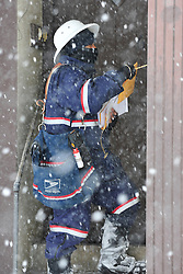 Mailman Simeon Reed makes his rounds through deep snow and blizzard conditions delivering mail on Broad Street Thursday, Feb. 13, 2014 in Bethlehem, PA. (AP Photo/Chris Post)