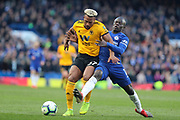 Wolverhampton Wanderers Forward Adama Traore (37) & Chelsea Defender Ngolo Kante during the Premier League match between Chelsea and Wolverhampton Wanderers at Stamford Bridge, London, England on 10 March 2019.