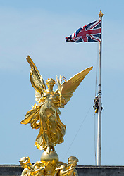 © Licensed to London News Pictures. 18/06/2015. London, UK. The flagpole at Buckingham palace  being inspected. Photo credit: Ben Cawthra/LNP