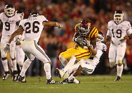 25 OCTOBER 2008: Iowa State wide receiver Darius Darks (80) is pulled down by Texas A&M defensive back Trent Hunter (22) in the first half of an NCAA college football game between Iowa State and Texas A&M, at Jack Trice Stadium in Ames, Iowa on Saturday Oct. 25, 2008. Texas A&M beat Iowa State 49-35.