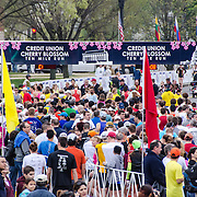 The crowds of runners gather at the start line at the start of the 2012 Cherry Blossom 10-Miler, the 40th running of the race that is run every spring in Washington DC to coincide with the National Cherry Blossom Festival. The course starts near the Washington Monument, heads over Memorial Bridge and back, goes up under the Kennedy Center, around the Tidal Basin and past the Jefferson Memorial, and then does a loop around Hains Point back to the finish near the Washington Monument.