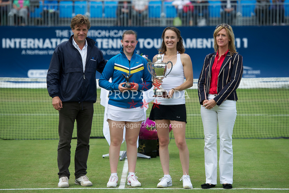 LIVERPOOL, ENGLAND - Saturday, June 18, 2011: Tournament Director Anders Borg with 2011 Women's Champion Martina Hingis (SUI) and runner-up Chloe Murphy during day three of the Liverpool International Tennis Tournament at Calderstones Park. (Pic by David Rawcliffe/Propaganda)