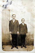fading and deteriorating image of two boys posing
