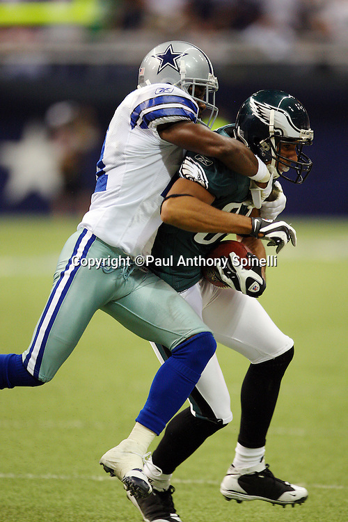 IRVING, TX - SEPTEMBER 15:  Cornerback Adam Jones #21 of the Dallas Cowboys tackles wide receiver Hank Baskett #84 of the Philadelphia Eagles on a pass play at Texas Stadium on September 15, 2008 in Irving, Texas. The Cowboys defeated the Eagles 41-37. ©Paul Anthony Spinelli *** Local Caption *** Adam Jones