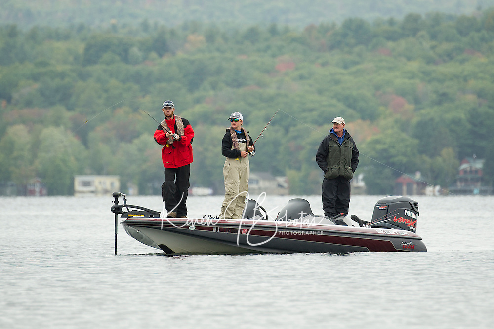 Hunter Kempf, Tanner Graves and Alan Denise from Keene High School keep their lines in the water up to the 2pm cutoff prior to weigh-in during the NHIAA State Bass Fishing Tournament held on Lake Winnisquam from Bartlett Beach on Saturday.  (Karen Bobotas/for the Laconia Daily Sun)