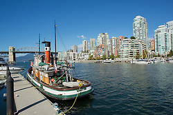 Canada, Vancouver, Granville Island, boats, bridge and aparment buildings