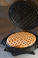 Waffle being made on a waffle iron