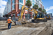 An excavator operator removes small pieces of pavement as part of one of the final rounds of utility work at 4th and Welsh.