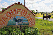 Farm sign of a cow and men in a horse drawn buggy in the Capitan Tomas area, Pinar del Rio, Cuba.