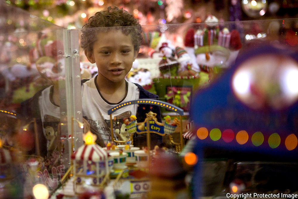 Brad Barquers, 6 looks at the Christmas Village in Cemaco.