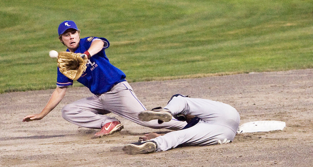 MIDDLETOWN, CT - 09 AUGUST 2010 -.East Longmeadow Post 293's Colin O'Neil misses a catch to second base as  Branford Post 83's Oliver Hart slides to the base during Monday's American Legion Northeast Regional Tournament Championship game at Palmer Field in Middletown. East Longmeadow lost, 2-1..Photo by Josalee Thrift