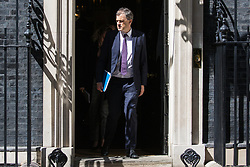 London, UK. 21 May, 2019. Julian Smith MP, Chief Whip, leaves 10 Downing Street following a mid-afternoon meeting. He left at around the same time as Foreign Secretary Jeremy Hunt, Home Secretary Sajid Javid, International Trade Secretary Liam Fox, Defence Secretary Penny Mordaunt, International Development Secretary Rory Stewart and Attorney General Geoffrey Cox and just before Prime Minister Theresa May left to make a statement on her Brexit Withdrawal Agreement Bill following Cabinet approval earlier in the day.