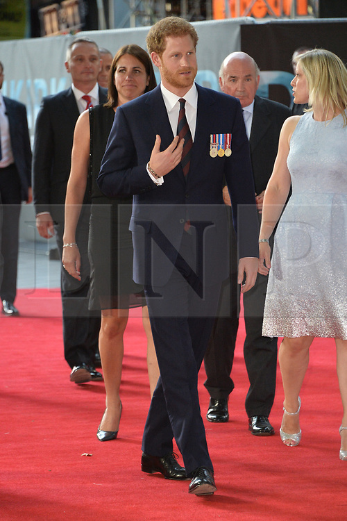 © Licensed to London News Pictures. 12/07/2017. London, UK. British Home Secretary Amber Rudd's hat blows away as she attends the Ceremonial Welcome at Horse Guards Parade for His Majesty King Felipe VI of Spain and Her Majesty Queen Letizia during a three day State visit. Photo credit: Ray Tang/LNP