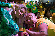 Brazilian fans watch the Brazil v Mexico game on a big screen at the top of Morro da Urca, the monolith that is halfway to Sugarloaf on the cable car route. The mountain was closed for a massive private party to show the Brazil v Mexico game. Scenes from Rio de Janeiro on the day that Brazil drew 0-0 with Mexico. Photo by Andrew Tobin/Tobinators Ltd