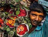 Young man at the flower market in New Delhi