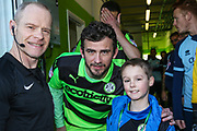 Matchday mascot with Forest Green Rovers Gavin Gunning(16) during the EFL Sky Bet League 2 match between Forest Green Rovers and Crawley Town at the New Lawn, Forest Green, United Kingdom on 24 February 2018. Picture by Shane Healey.