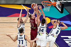 Rolands Smits of Latvia between Luka Doncic of Slovenia, Goran Dragic of Slovenia, Gasper Vidmar of Slovenia and Edo Muric of Slovenia during basketball match between National Teams of Slovenia and Latvia at Day 13 in Round of 16 of the FIBA EuroBasket 2017 at Sinan Erdem Dome in Istanbul, Turkey on September 12, 2017. Photo by Vid Ponikvar / Sportida