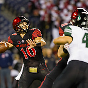 24 November 2018: San Diego State Aztecs quarterback Christian Chapman (10) drops back to pass a 76 yard touchdown pass in the first quarter to Fred Trevillion (not pictured) to give the Aztecs a 7-3 lead. The Aztecs closed out the season with a 31-30 overtime loss to Hawaii at SDCCU Stadium.
