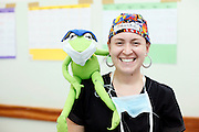 Operation Smile Volunteers in action at the Clinique Ngaliema in Kinshasa. Patient Imaging technician Brooke Gordon with Kermet the frog...Operation Smile South Africa.Clinique Ngaliema, Avenue Des Cliniques.KInshasa, DRC Mission, June 3rd-12th 2011..© Zute & Demelza Lightfoot.www.lightfootphoto.com...