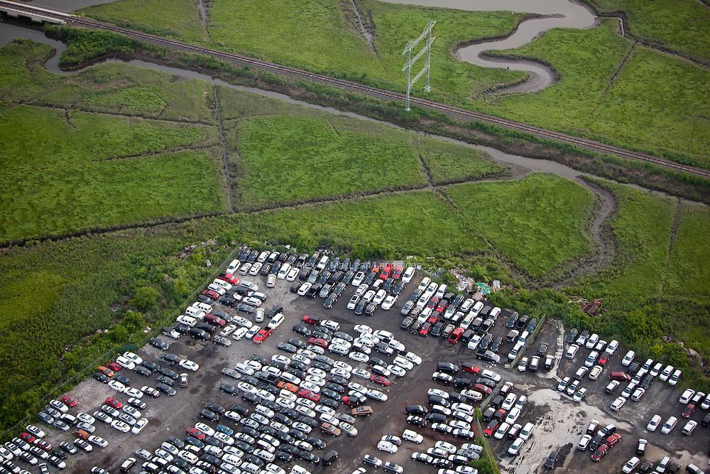 A car lot on the edge of the wetland habitat near Fresh Kills Landfill