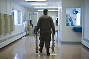 Corrections officers carry chains into Deerfield Correctional Facility before transporting the last 33 of 1,200 prisoners out of the closing prison in Ionia, MI, Friday, March 20, 2009. All employees have been absorbed into the four other prisons in the town.
