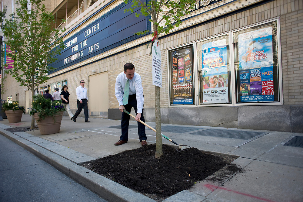 Mayor Luke Ravenstahl helps plant a tree along the 900 block of Penn Avenue following a Root for Trees Rally at Katz Plaza in Pittsburgh. The tree planting was part of TreeVitalize efforts to plant 20,000 new trees in the Pittsburgh area by 2012.