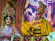 04 OCTOBER 2016 - BANGKOK, THAILAND: Chinese opera being performed at the Vegetarian Festival at the Chit Sia Ma Chinese shrine in Bangkok. The Vegetarian Festival is celebrated throughout Thailand. It is the Thai version of the The Nine Emperor Gods Festival, a nine-day Taoist celebration beginning on the eve of 9th lunar month of the Chinese calendar. During a period of nine days, those who are participating in the festival dress all in white and abstain from eating meat, poultry, seafood, and dairy products. Vendors and proprietors of restaurants indicate that vegetarian food is for sale by putting a yellow flag out with Thai characters for meatless written on it in red.     PHOTO BY JACK KURTZ