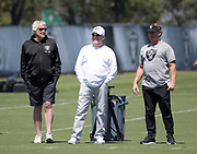 May 3, 2019; Alameda, CA, USA; Oakland Raiders athletic trainer Rod Martin (lef), owner Mark Davis (center) and coach Jon Gruden watch during rookie minicamp at the Raiders practice facility.