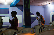Bunmi Aiyenura, 23, right, prays during a Wednesday evening service at Christ Embassy church, in the Badia neighborhood of Lagos, Nigeria, September 4, 2013.  Bunmi says she has had eight pregnancies by the same boyfriend-- seven of which ended in abortion-- and says she has not ever been educated about birth control.  The last pregnancy ended in miscarriage and her boyfriend, who was finally ready for a child, left her for her best friend.
