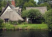 Thatched Bridge Cottage at Flatford, East Bergholt, Suffolk, England
