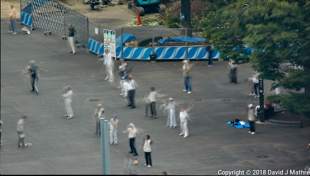 Early Morning Strech and Exercise at Niagara Falls in Shinjuku Chuo Park in Tokyo. Composite of 7 mages taken with a Nikon 1 V3 camera and 70-300 mm VR lens from my hotel room on the 20th floor in the Keio Plaza hotel (aprox. 400 meters distance).<br /> Photoshop, Statistics, Mean.