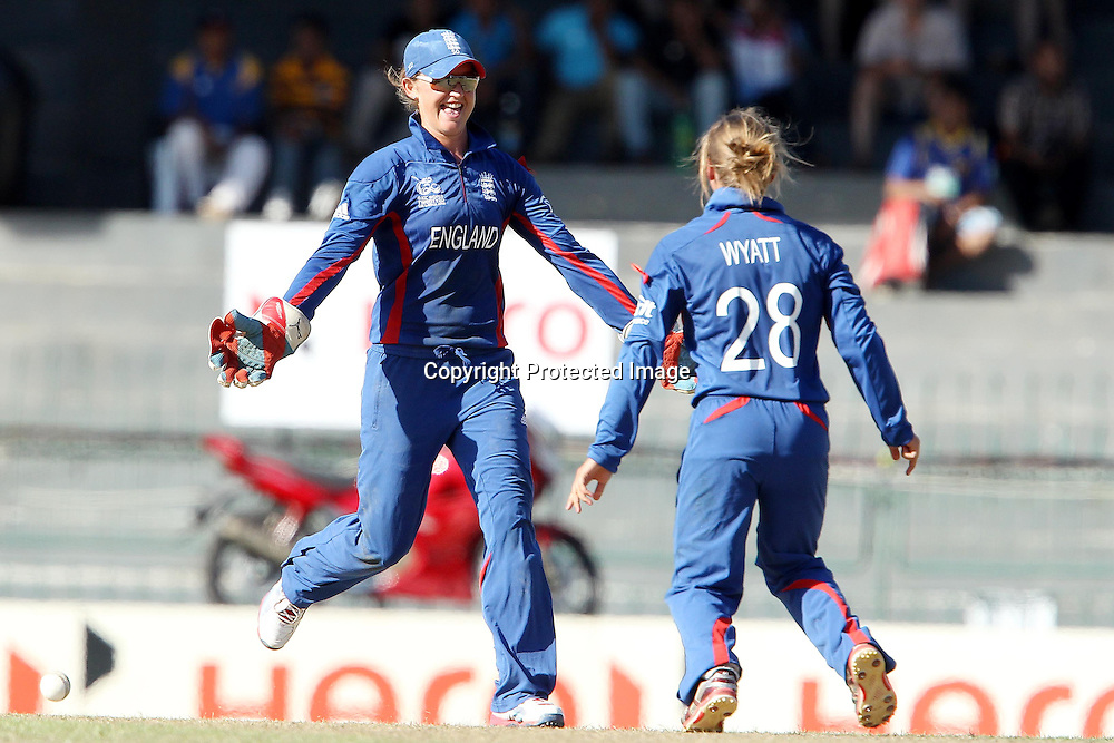 Danielle Wyatt of England and Sarah Taylor of England celebrates the wicket of Katey Martin of New Zealand  during the ICC Women's World Twenty20 Semi final match between England and New Zealand held at the Premadasa Stadium in Colombo, Sri Lanka on the 4th October  2012<br /> <br /> Photo by Ron Gaunt/SPORTZPICS/PHOTOSPORT