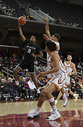Long Beach State 49ers guard Jordan Griffin (11) is defended by Southern California Trojans forward Bennie Boatwright (25) and guard Jordan Usher (1) during an NCAA basketball game in Los Angeles, Nov 28, 2018. USC defeated Long Beach State 75-65.