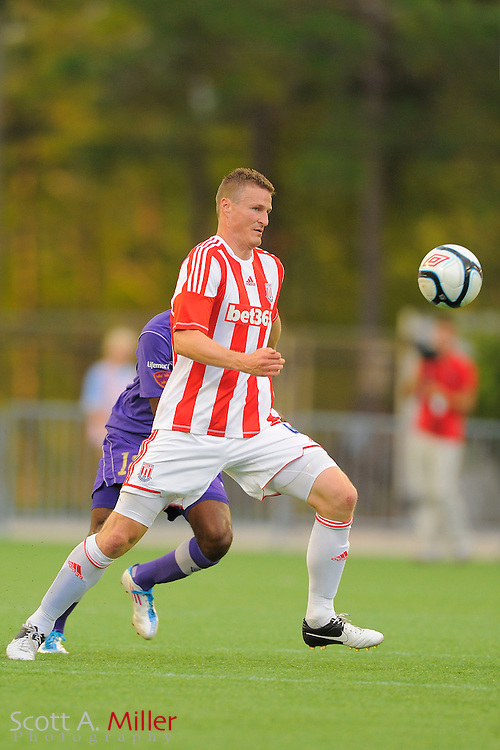Stoke City Potters defender Robert Huth (4) in action against the Orlando City Lions at the Florida Citrus Bowl on July 28, 2012 in Orlando, Florida. Stoke won 1-0...© 2012 Scott A. Miller.