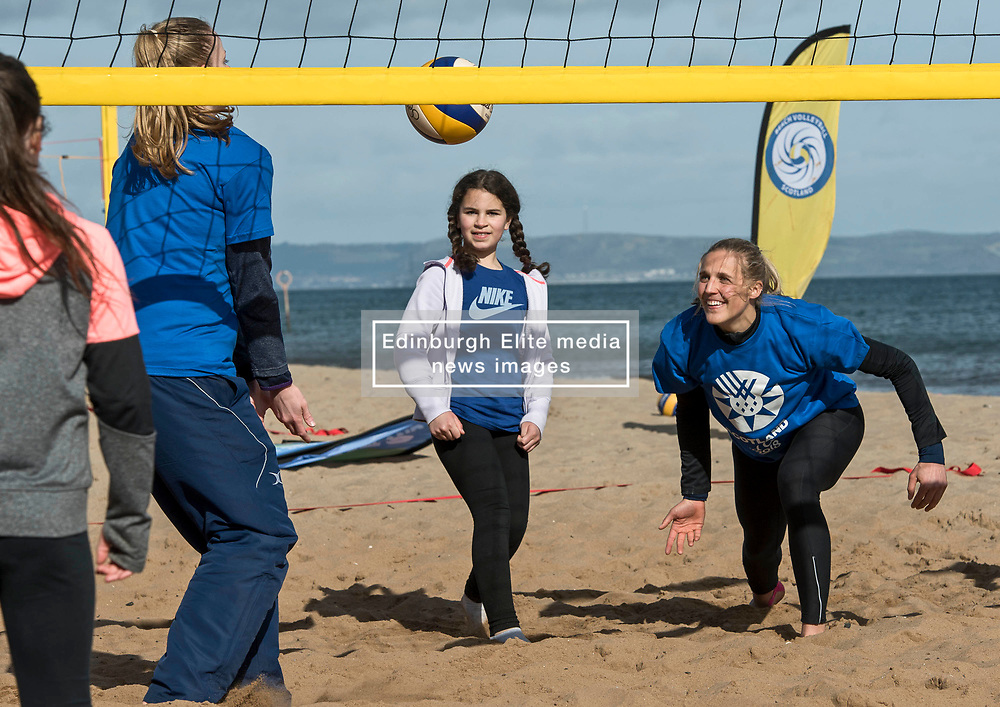Today marks one year to go before the next Commonwealth Games get underway in Gold Coast, Australia. Athletes from a number of sports joined Scottish Beach Volleyball players, including top duo Lynne Beattie and Mel Coutts, on the new permanent courts on Portobello Beach this morning. The athletes joined with children from Towerbank Primary School to try out the game in the Portobello sunshine.   Pictured: Becky Merchant with Towerbank children<br /> <br /> <br /> © Jon Davey/ EEm