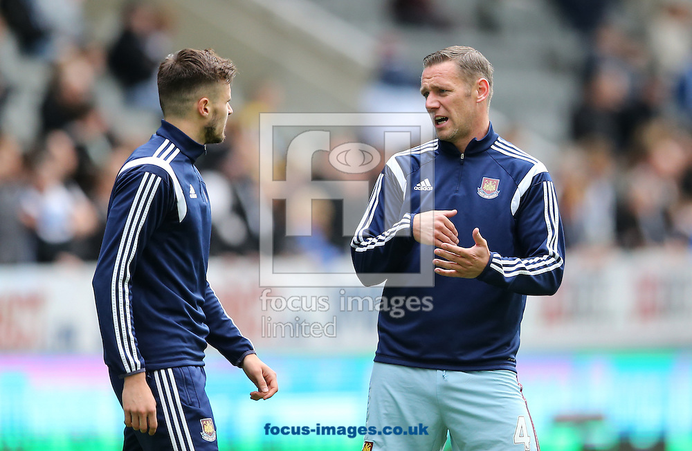Kevin Nolan (r) speaking to Carl Jenkinson of West Ham United prior to the Barclays Premier League match at St. James's Park, Newcastle<br /> Picture by Simon Moore/Focus Images Ltd 07807 671782<br /> 24/05/2015